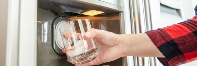 Person Getting Water From Fridge