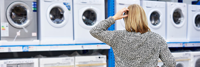 Woman Considering Buying A New Washing Machine