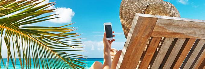Woman Using Phone On Beach