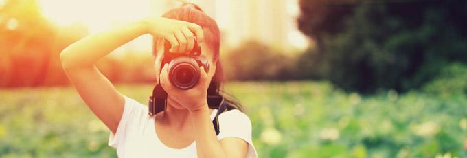 Girl Taking Photo In Field