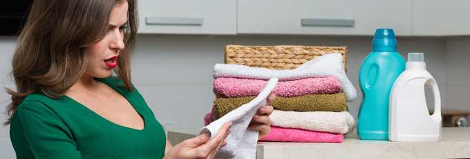 Woman Folding Piles Of Laundry
