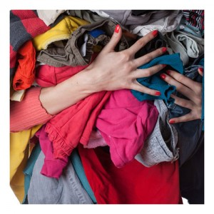 Woman Holding Armfuls Of Laundry