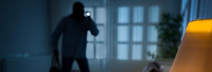 Burglar Entering Home At Night