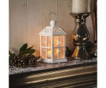White Lantern On Christmas Decorated Mantlepiece
