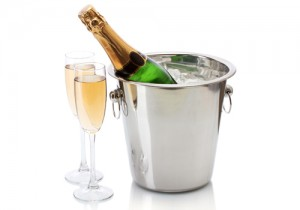 Champagne In Glasses And Bottle In Ice Bucket