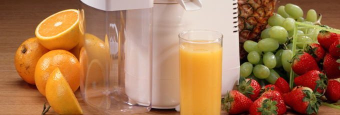 Juicer With Glass Of Orange Juice And Fruit