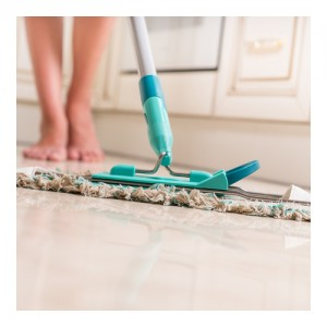 Young Woman Mopping Kitchen Floor