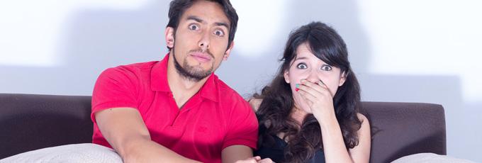 Shocked Couple On Sofa