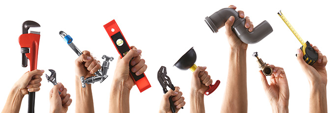 Selection Of Hands Holding Maintenance Tools