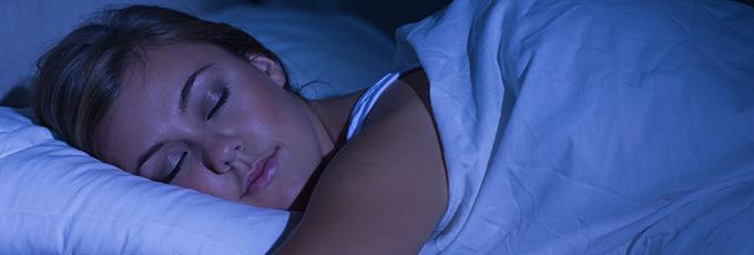 Woman Sleeping In Dark Room