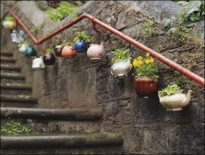 Flowers Hanging In Teapots