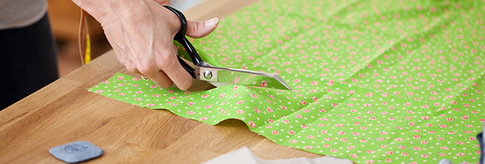 Scissors Cutting Through Fabric