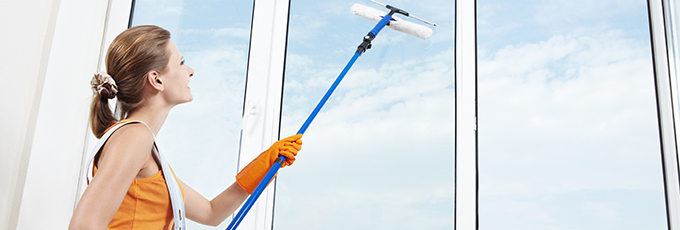 Woman Cleaning Windows Outside