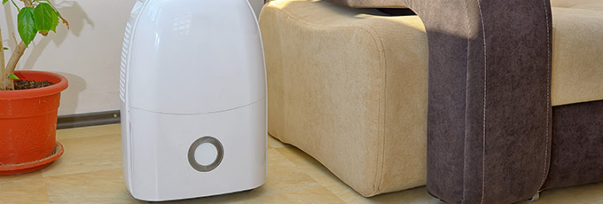 Portable dehumidifier in room
