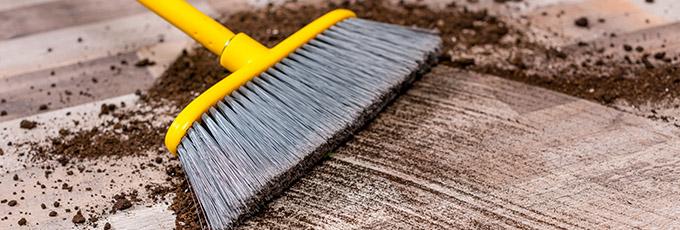 Sweeping dirty floor