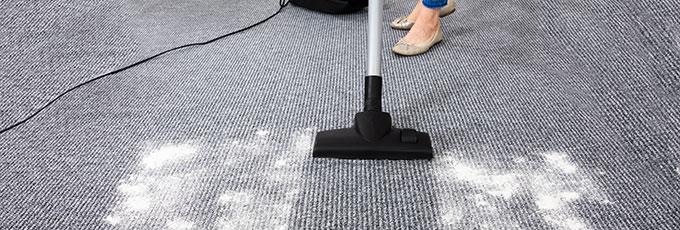 Vacuuming bicarbonate of soda on carpet