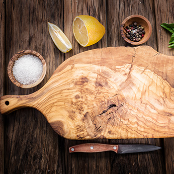 Wooden chopping board with lemons and salt