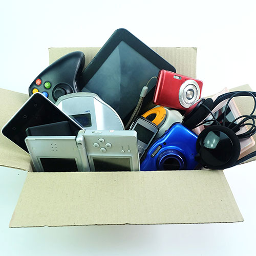 Old electronic gadgets in a box